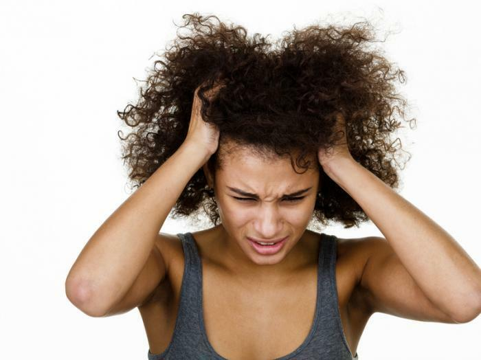 Unhealthy scalp itchy woman natural hair